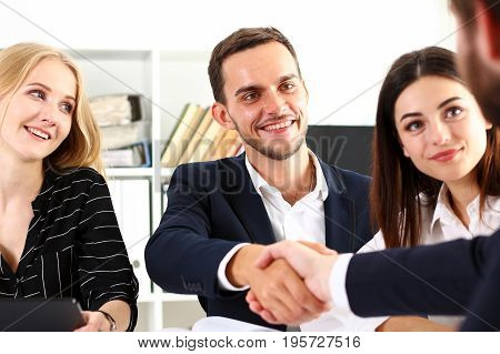 Smiling Man In Suit Shake Hands As Hello In Office