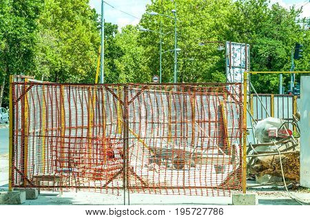 Building construction site entrance with gate of construction site safety net.