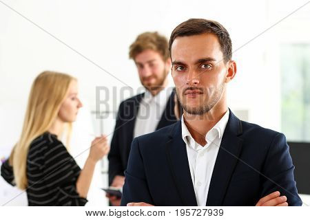 Handsome man in suit and tie look in camera hands crossed on chest isolated background. White collar dress code modern office lifestyle graduate college study profession idea coach train concept