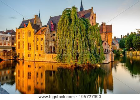 Bruges (Brugge) cityscape with water canal at sunset, Flanders, Belgium