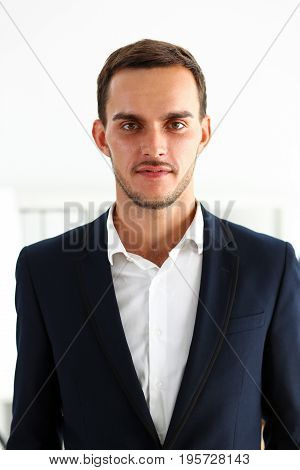 Handsome Smiling Man In Suit Stand In Office