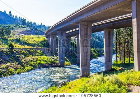 Tall Concrete Highway Overpass Crossing Over Mountain River