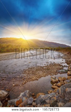 mountain river in autumn. Rocky shore. Multi-colour wood.