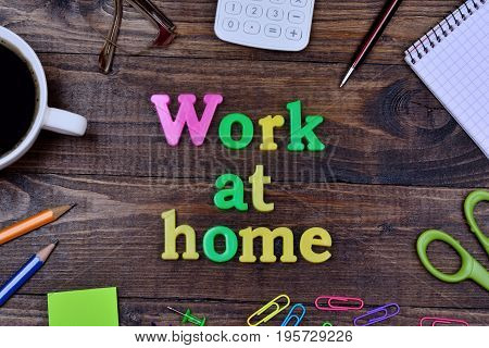 The words Work at home on wooden table