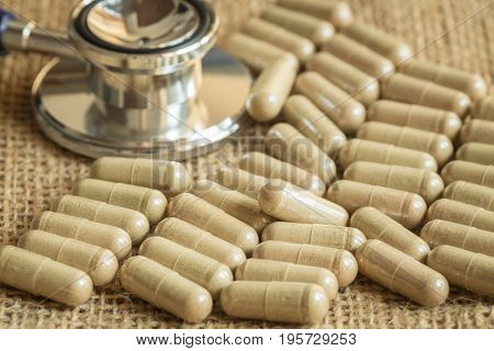 Herbal capsules from herbs on wooden table,Closeup shots of capsules