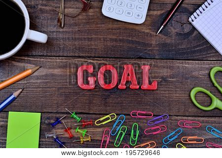 The word Goal on wooden table close-up