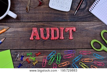 The word Audit on wooden table close-up