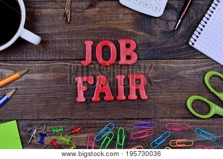 The words Job fair on wooden table