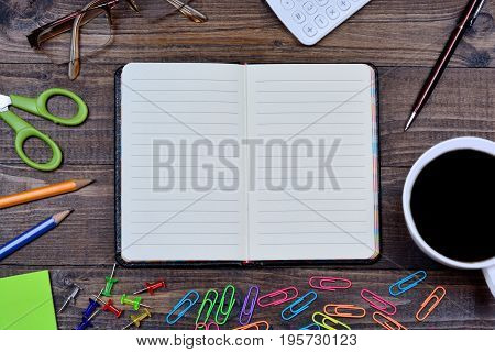 Many business objects on wooden table close-up