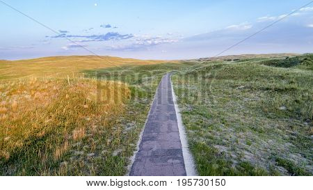 Narrow, one lane road in Nebraska Sandhills, aerial view