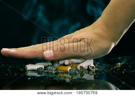 Close up of a hand representing a STOP Smoking. World no tobacco day.