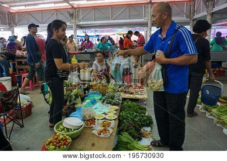 Keningau,Sabah,Malaysia-June 29,2017:Local people buying various vegetables at the local market Tamu in Keningau,Sabah.Its a place where all farmers,fishermen & vendors gathers weekly to sell their products