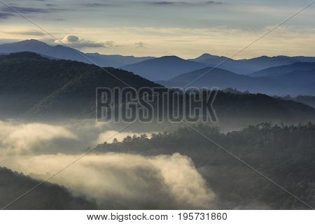 Foggy Valley and Mountain Tops at Dawn