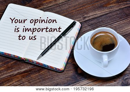 Text Your opinion is important to us on notebook page