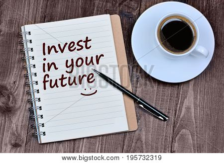 The words Invest in your future on notebook page