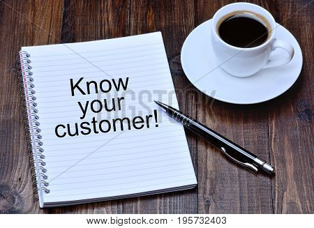 Know your customer on notebook page close-up