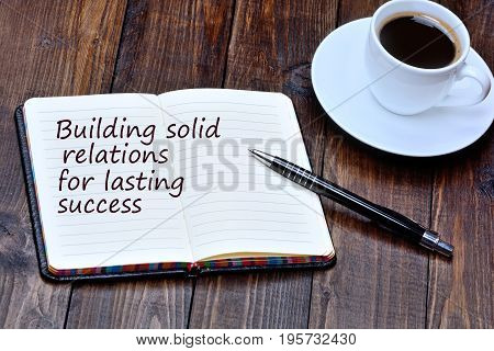 Building solid relations for lasting success on notebook page