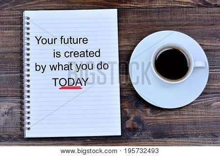 Your future is created by what you do today text on notebook page