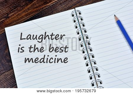 Laughter is the best medicine words on notebook page