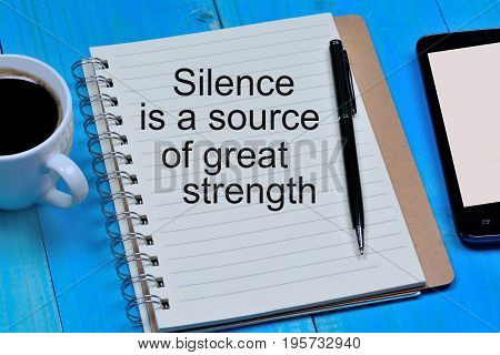 Silence is a source of great strength text on notebook page