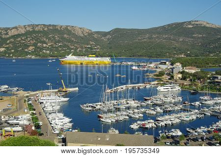 View Of Porto Vecchio Harbor With Ferry Boat Ready To Leave.