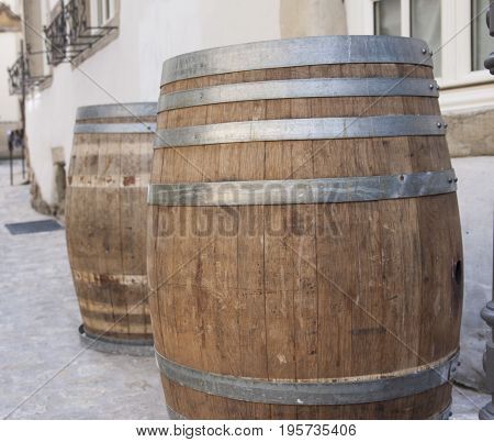 Wood barrels containing alcohol, on a street