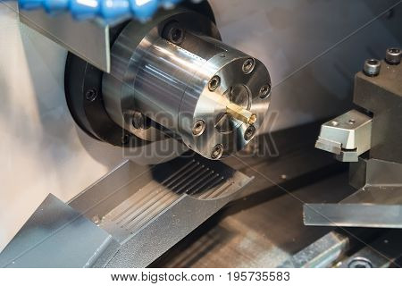 CNC lathe machine or Turning machine cutting the copper part .Hi technology manufacturing