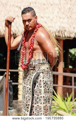 Honolulu Hawaii - May 27 2016:A Samoan Man poses for photos in the Village of Samoa at the Polynesian Cultural Center.