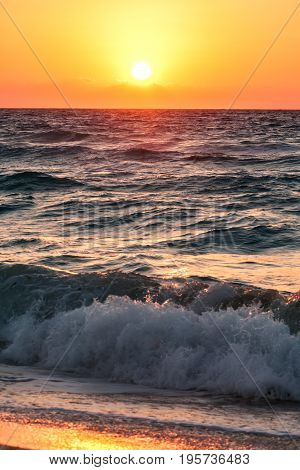 Beautiful tropical sunrise on the beach over ocean early morning in Mexico Cancun