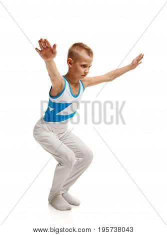 Young athletic boy doing stretching exercises before training