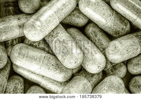 Heap of herb capsules medicine for health close-up