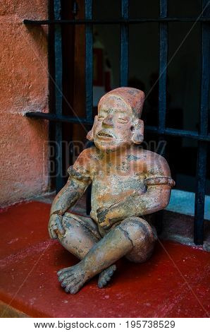 Pre Columbian figurine made of red clay