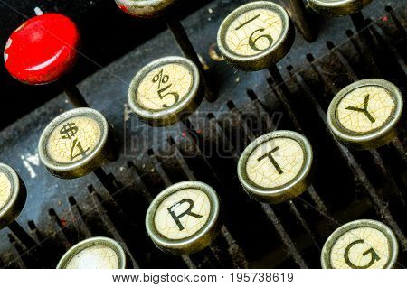 Old typewriter keyboard with fragmented type keys