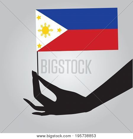 Flag of Philippines in a female hand. Vector illustration.