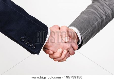 Two businessmen handshaking on gray background