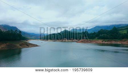 A scenic view of a lake near Munnar, Tamil Nadu