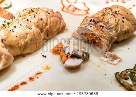 Carving of stuffed chicken breast groumet food