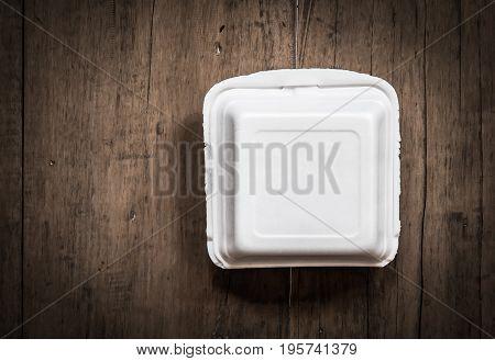 white empty foam box on wood background