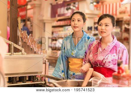 Japanese Women Choosing Street Food Snack