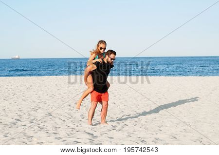 Happy Young Joyful Couple Together During Summer Holidays Vacation On Tropical Beach.