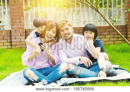 Outdoor portrait of a happy asian family