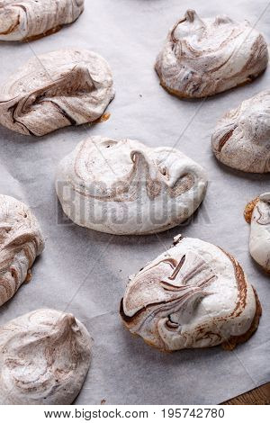 Homemade marble chocolate meringue cookies on a baking sheet