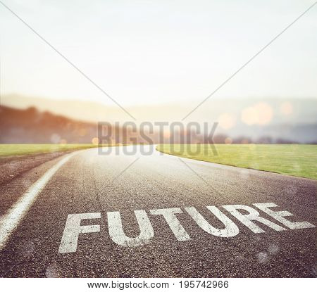 Road with future writing on the asphalt with sun in front