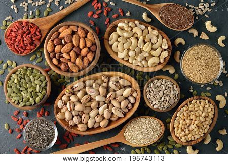 Different superfoods on a gray background healthy eating concept