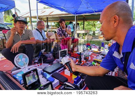 Keningau,Sabah,Malaysia-June 29,2017:Local people buying various electronic street shop at the local market Tamu in Keningau,Sabah.In Tamu there are many cheaper Chinese electronic gadget for sale.