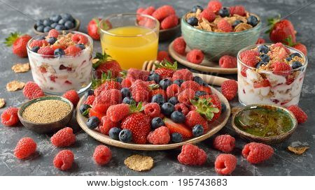 Various fresh berries on a gray background
