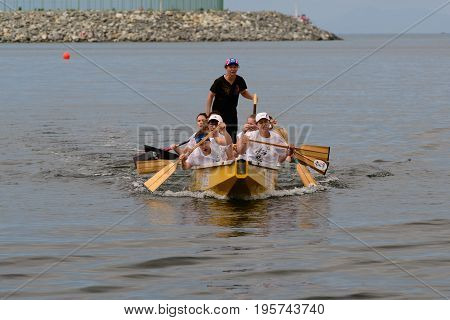 Vladivostok Russia -  July 14 2013: The group of women floats on a dragon boat.