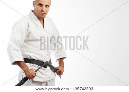 Man In White Kimono Posing On White Background