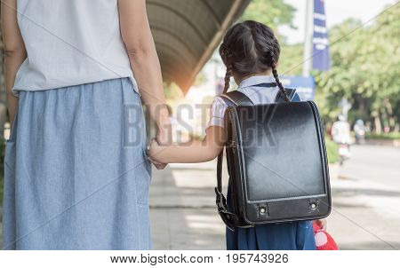 Mother's Hand Lead His Child Daughter Go To School