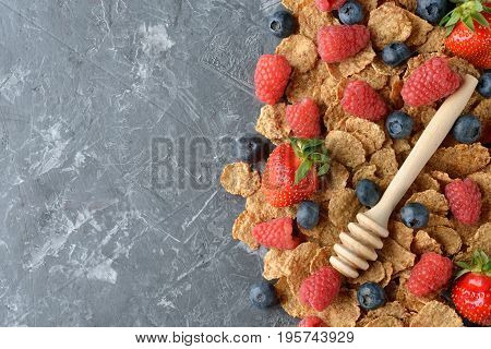 Wheat flakes with fresh berries concept of healthy eating